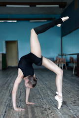 Young ballet dancer practising in the studio