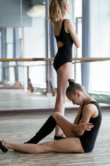 Two young ballet dancers in the studio during the break