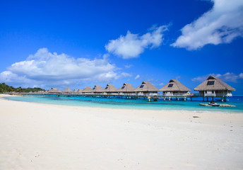 White sand beach and overwater villas in  Bora Bora