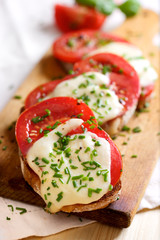 Bruschetta with fresh tomato, mozzarella cheese  and chive