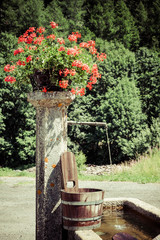 old well and wooden bucket