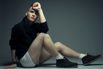 Men's fashion concept. Young man in underwear