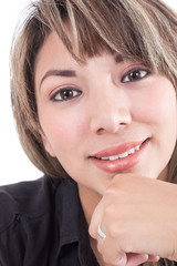 closeup of latin girl smiling with hand under her face