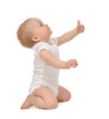 Leinwanddruck Bild - Infant child baby toddler smiling with hand thumb up sign