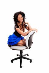 Girl kneeling on chair.