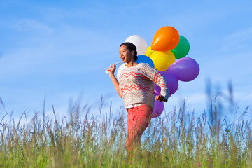 Outdoor portrait of a young African American teenage girl runnin