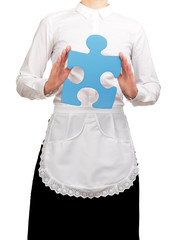 Photograph of a bust waitress holding a blue puzzle piece