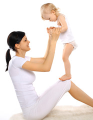 Happy mom and baby doing exercise