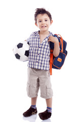 Full body portrait of happy school kid holding a soccer ball, is