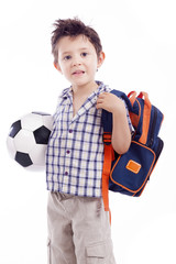 Happy school kid holding a soccer ball, isolated on white backgr
