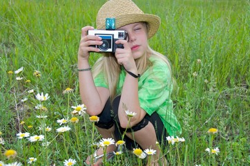 little girl with old camera and fedora