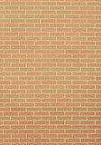 Closeup of orange yellow brick wall as background or texture