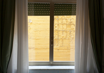 Hotel room with wall view.