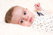 Beautiful Baby Girl in Spotty Top on Cream Fur Rug