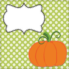 Pumpkin on a green polka dot background
