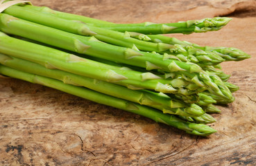 ripe green asparagus on a wooden background