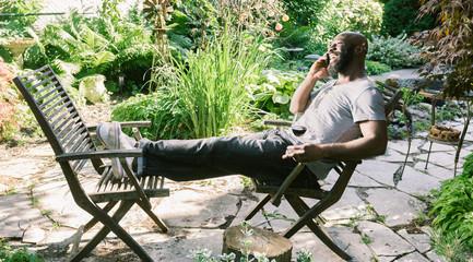 Man Texting in Garden
