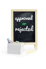 Approved or Rejected  word on blackboard, on white Clipping path