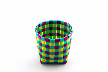 Color plastic basket on white background.