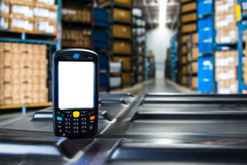 Bluetooth barcode scanner in front of modern warehouse