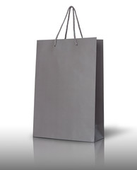 Gray paper bag on white background