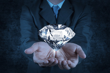 businessman hand holding 3d diamond as concept