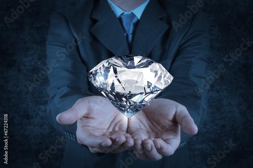 canvas print picture businessman hand holding 3d diamond as concept