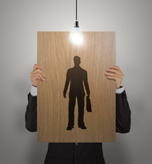 businessman hand with poster choosing people icon as human resou