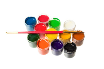 Paints and brushes isolated on white background