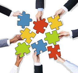 Group of Hands with Jigsaw Puzzle