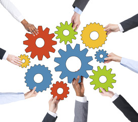 Business People Holding Gears Together