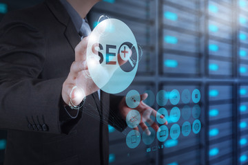 businessman hand showing search engine optimization SEO as conce