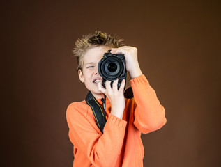 Child in studio with professional camera.