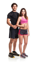 Athletic couple - man and woman with thumb up on the white