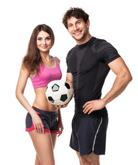 Athletic man and woman with ball on the white