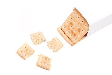 a packet of biscuits and one broken isolated on white background
