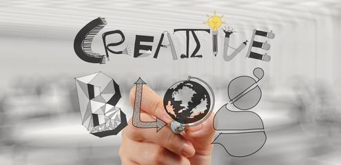businessman hand draws creative blog as concept