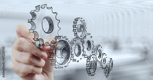 Leinwanddruck Bild businessman hand draws gear to success