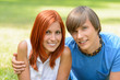 Teenage couple enjoy summer day smiling