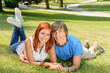 Smiling couple lying in park first love
