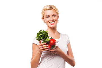 young smiling woman with a plate full of healthy food. diet