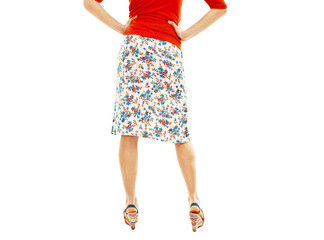 Woman wearing floral skirt and striped sandals from the back