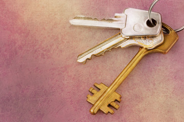 Three house keys on keyring over grunge background