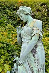 Sculpture of 19 century in public garden Botanique