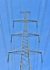 Contemporary high voltage electric pole on blue sky