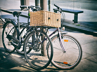 Styled as old photo of vintage bicycles parked