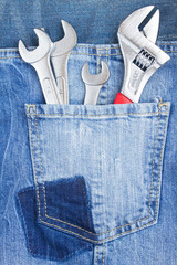 set of spanners in jeans pocket
