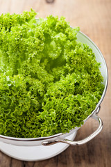 fresh lettuce leaves in colander