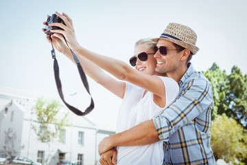 Stylish young couple taking a selfie