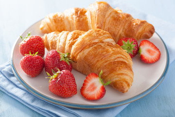 fresh croissants with strawberry for breakfast